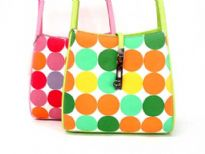 Big Polka Dots Double Handle Bucket Style Bag with cosmetic bag inside. Top zipper closure.
