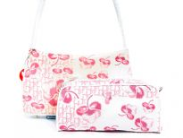 Shoulder bag has a cotton flower pattern, a top zipper closure and a single strap. Cosmetics bag has a top zipper closure. Made of jacquard.