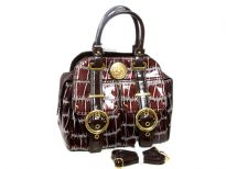 Double strapped PVC Fashion Handbag made with multiple extra outer compartments and buckles. Magnetic closure on top.