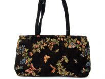 Tapestry Bag has a nature design on both sides with flowers and butterflies. Bag has a top zipper closure, polyester lining, and a double handle. Made of cotton fabric.