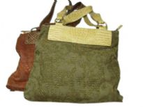 Jacquard fabric handbag made with double shoulder straps and a top zipper closure.