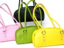 Designer Inspired Handbag has a top zipper closure and double handle. Made of nylon.