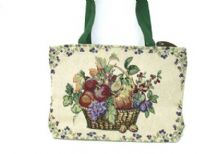 Woven Jacquard Tote Bag in Rectangular shape. Multi colored fruit basket pattern with stems border in the front. Little beading around the basket in front. Top zipper closure and fabric double handle. The back of this bag is solid Green color; the same color Green as shown on the straps.
