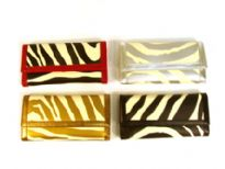Designer Inspired Zebra Print PU Check Book wallet. Wallet has a magnetic closure. Made of faux leather.