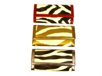 Designer Inspired Zebra Print check Book wallet. Wallet has a magnetic closure. Made of faux leather.