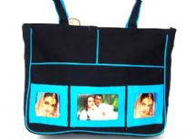 Picture bag made with double adjustable shoulder straps.  Made of 100% Cotton. Top zipper closing.