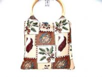 Cotton Tapestry Bag made with a wood double ring handle. Bag has a patchwork pattern.