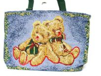 Hand beaded tote bag assembled with two holiday spirit bears.  Made of 100% Cotton.