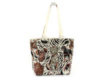 Multi animal print design hand beaded tapestry bag.  Made with double shoulder straps.  Made of 100% Cotton.