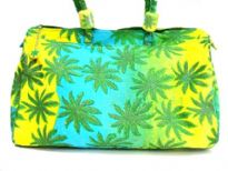 Leaf plant inspired duffle type beach bag. Bag has a double handle and a top zipper closure.  Made of 100% Cotton.