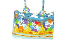 Beach inspired beach bag embellished with double shoulder straps and a zipper closure.  Made of 100% Cotton.