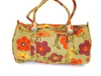Beach bag has a floral pattern, a top zipper closure and double shoulder straps.  Made of 100% Cotton.