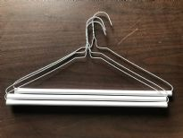 "14.5G Laundry Dry Cleaners Strut Hangers. 16 Inches. These are brand new hangers used for pants made of white wire and a white cardboard tube which has adhesive on it to keep the pants from sliding off.  Industrial quality that is made to last. These are 16"" wide 14.5 Gauge wire."