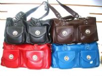 PVC Handbag has a top zipper closure and a double handle. Bag has outside pockets with twist lock closure.