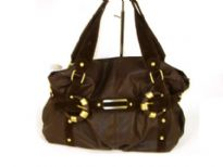 Glossy PVC fashion handbag with straps accent in suede fabric. Double shoulder straps with top zipper closure.
