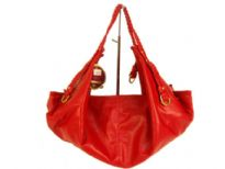 Designer Inspired Hobo Bag with a single strap and a zipper closure. Made of faux leather.