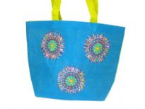 Jute handbag embellished with a floral design has a double shoulder straps.