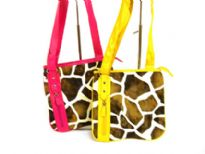 Designer Inspired Giraffe Print Crossbody Bag with zipper closure. Made of faux leather.