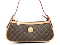 Genuine Leather Trim Fashion Handbag has a single strap and top zipper closure.