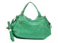 PVC Fashion Handbag.Top zipper closing. Front and Back zipper pockets. Center divider and shoulder strap.