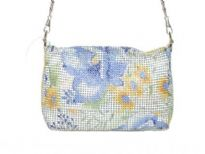 Hand painted metal mesh bag made with a top zipper closure and a detachable shoulder strap.