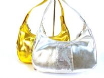 Metallic color polyurethane with sequin patch work evening bag. It has zipper closure and has single handle.