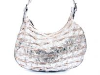 Metallic PVC shoulder bag. top zipper closing. Center divider.