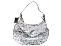 Metallic color Fashion Handbag.  Top zipper closing.