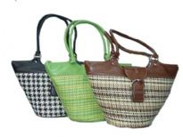 Multi colored woven fabric bag for any occasion made with a front flap buckle closure and double shoulder straps. Bucket style bag has hard base with PVC straps & details.