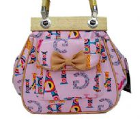 Fashionable shoudler bag has a multi color letter pattern, a top zipper closure, a double handle, and an outside pocket with bow detail. Made of faux leather.
