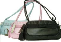 Fashionable shoudler bag has a top zippper closure, a double handle with twist detial. Made of faux leather.