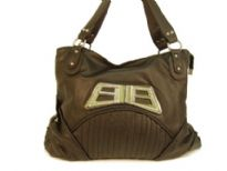Designer Inspired Shoulder Bag with accentuating metal design. Bag has a zipper closure and a double handle. Made of polyurethane.