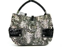 Animal print Fur fashion handbag embellished with a top zipper closure with a hanging bracelet handle and a single shoulder strap.  Outer bold compartments also accentuate this bag.