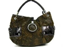 Animal print Fur fashion handbag embellished with a top zipper closure with a hanging bracelet handle and a single shoulder strap.  Outter bold compartments also accentuate this bag.