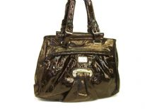 Fashion Handbag made of polyurethane material. This is a double strap bag with belt buckle like straps and a top zipper closure.