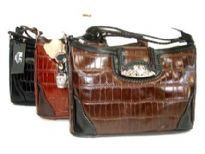 Genuine Leather handbag with clasp over zipper closure.
