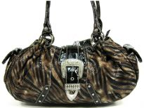PVC animal print fashion handbag assembled with a front flap along with hardware and studs. Bag has side and inside pocket compartments along with a top zipper closure and double shoulder straps.