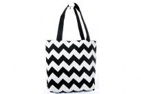 PVC Zig-Zag Print shopping Tote. Top zipper closing.