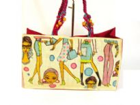 Fashion Printed Jute bag has a double beaded shoulder straps and a magnetic closure.