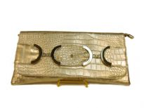 Croco embossed PVC clutch Bag has metal details and a magnetic closure and a an inside zipper closure.