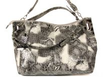 PVC Fashion Handbag has an animal print multi patch pattern, a top zipper closure, a double handle and a detachable shoulder strap.