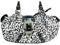 Leopard Print Faux Patent leather handbag has double handle, side pockets, zipper closure topped with a studded belt.