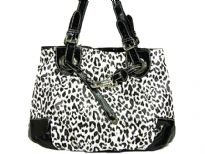 Leopard printed tote bag has a double handle, a top zipper closure and a drawstring detail. Made of PVC.