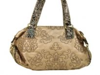 Designer Inspired Embroidered Shoulder Bag with zipper closure. Bag has a double handle with animal print pattern. Made of PU (polyurethane).