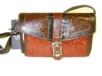 Genuine Leather handbag with flap over zipper closure inside the bag.
