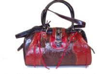 Genuine Leather bag with top zipper closure, double handle & clasp like closure over the top.