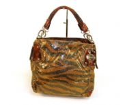 Designer Inspired Metallic Zebra Print Small Handbag with zipper closure and a double handle. Made of PU (polyurethane)