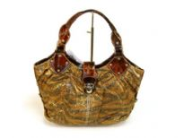 Designer Inspired Metallic Zebra Print Hobo Bag has push lock closure and a double handle. Made of PU (polyurethane)