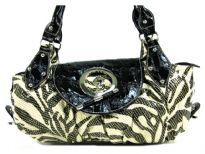 Designer Inspired Metallic Zebra Print Shoulder Bag with large toggle closure on top & also has a zipper closure. Double handle bag is made of PU (polyurethane).