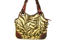 Metallic Zebra Print Handbag with contrasting burgundy colored double straps & patchwork on the front corners of the bag with top zipper closure.